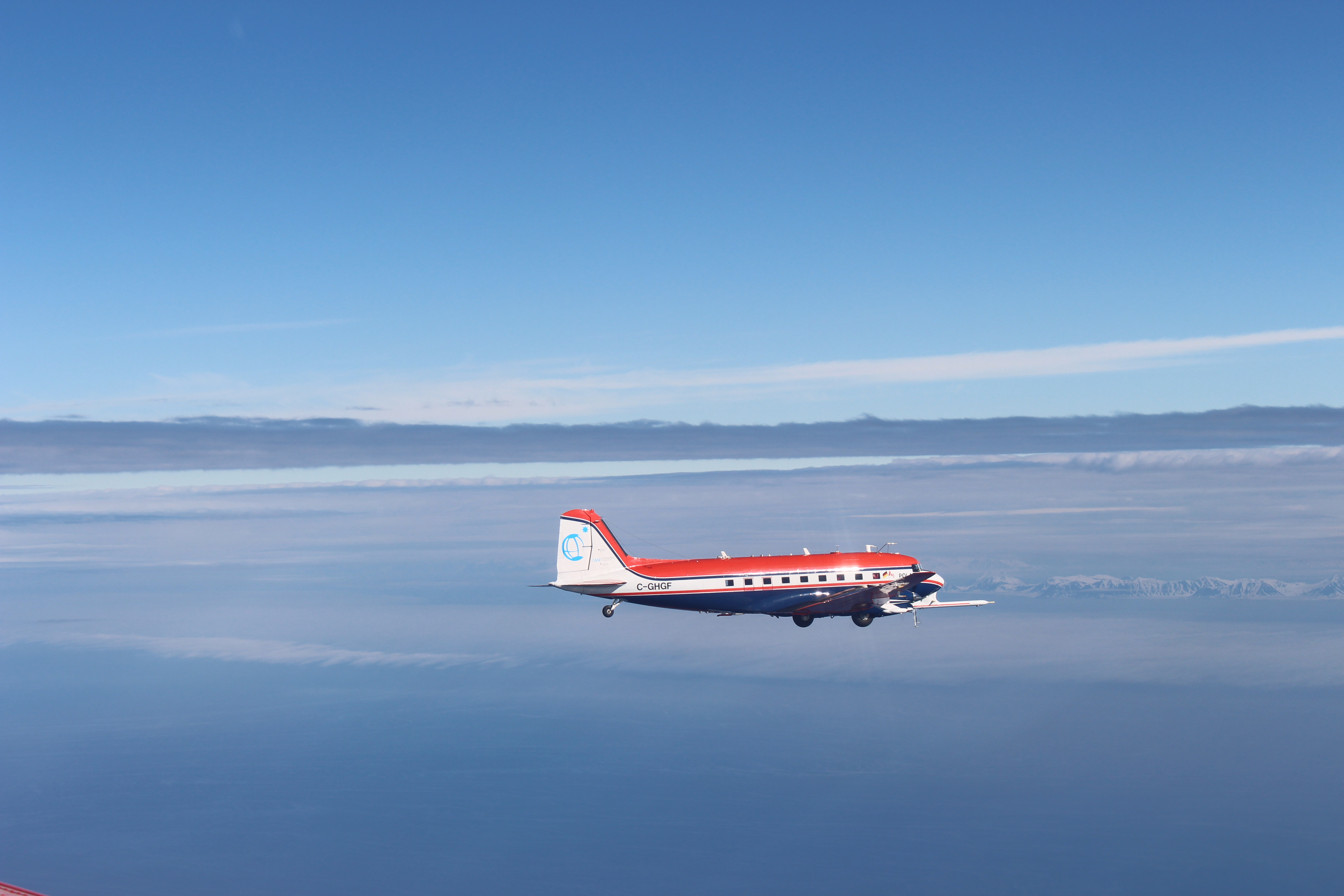 The German research aircraft Polar 6 flying over Arctic low level clouds during ACLOUD.